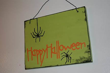 happy halloween sign with spiders