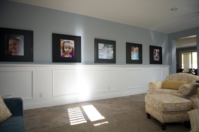 decorating with portraits long entryway filled with happiness