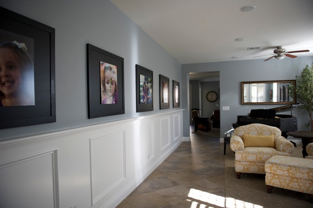 living room portraits. Really really love what Emily has done for this big space  and I m sure her kids adore it too Please email me with some other ides on displaying portraits Decorating Portraits Long entryway filled happiness
