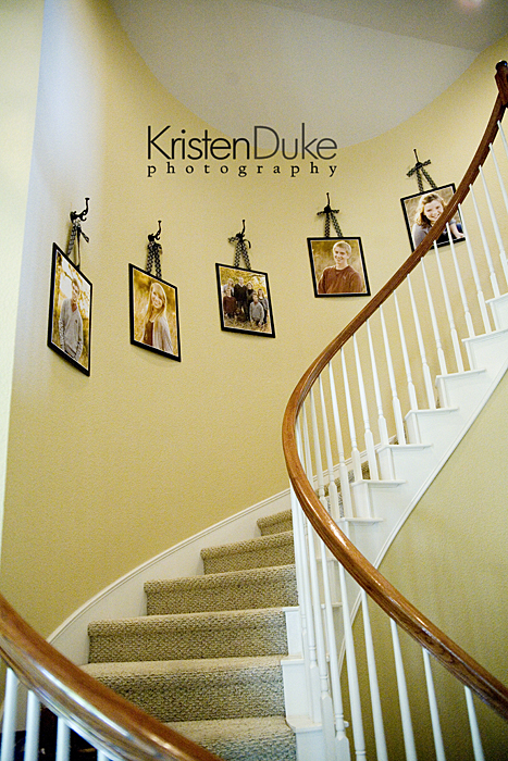 Decorating with portraits up the stairs capturing joy - How to decorate a staircase ...