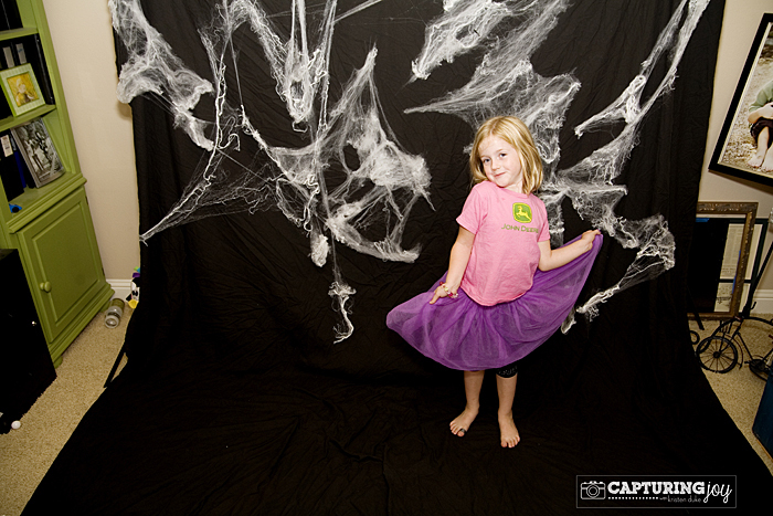 black photo backdrop with spider webs
